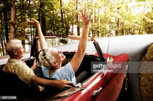 senior couple going for a drive - convertible stock pictures, royalty-free photos & images