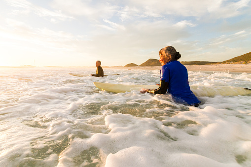 Senior couple going surfing together - gettyimageskorea