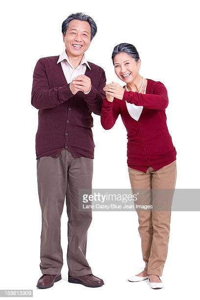 Senior couple greeting for Chinese New Year