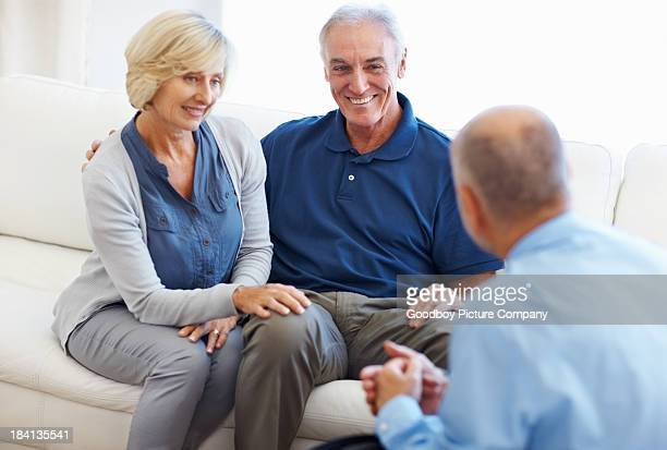 Senior couple having a conversation with financial planner