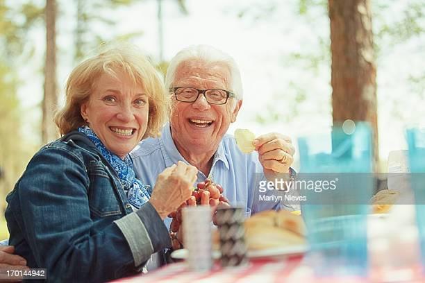 senior couple having a cookout