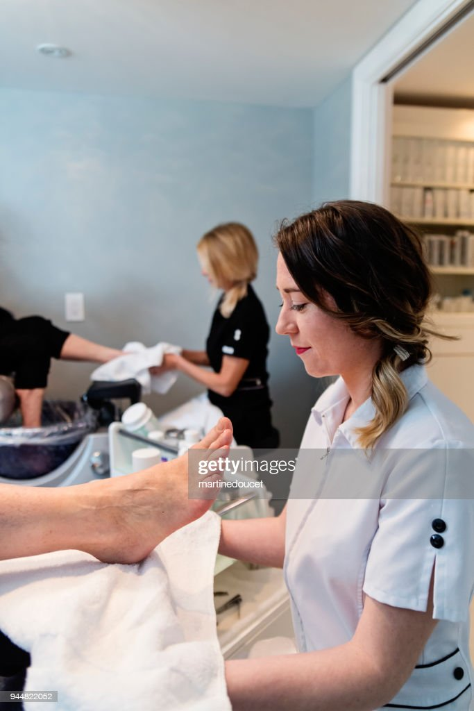 Senior couple having a pedicure in a beauty spa. : Stock Photo