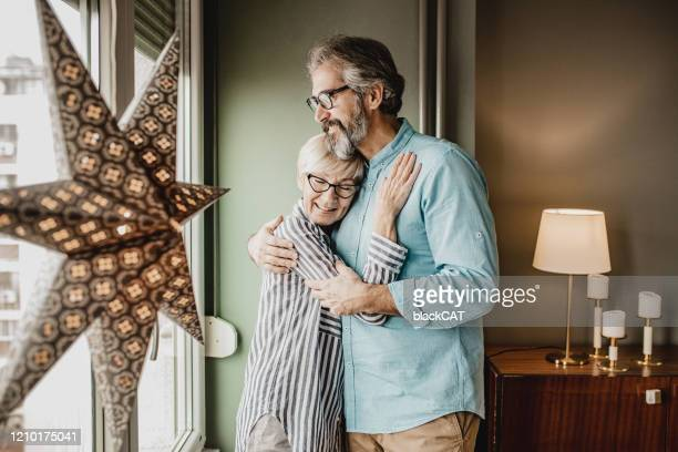 senior couple having a romantic moment at home - life events stock pictures, royalty-free photos & images