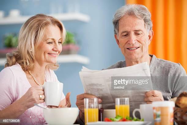 Senior couple having breakfast.