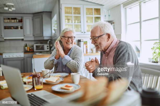 senior couple having breakfast - active senior woman stock photos and pictures