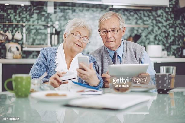 Senior couple having breakfast together