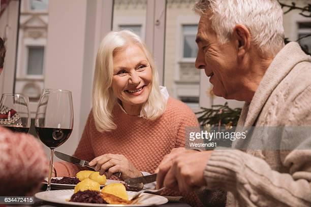 Senior couple having Christmas dinner