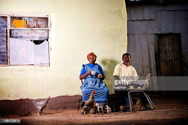 senior couple having coffee and rusks infront of shelter - south african culture stock photos and pictures