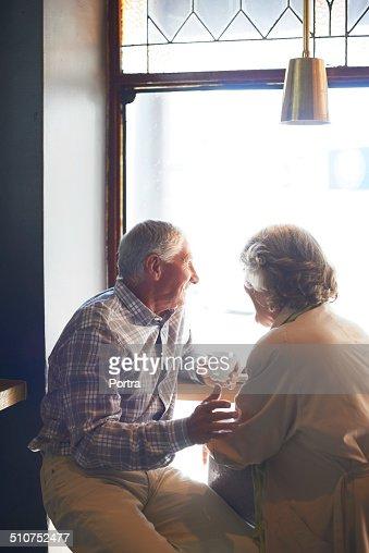 Senior couple having coffee at cafe