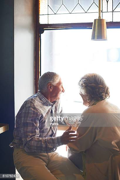 Senior couple having coffee at cafe