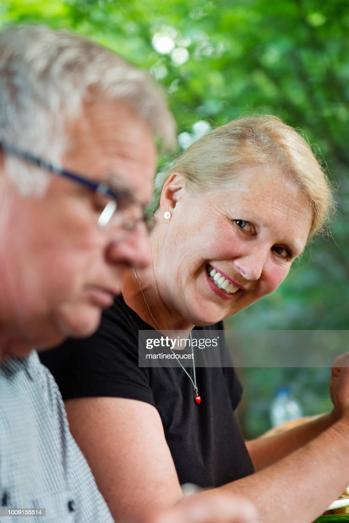 Senior couple having dinner in summer house. : Stock Photo