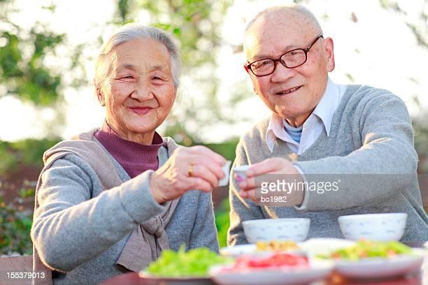 senior couple having dinner in the garden
