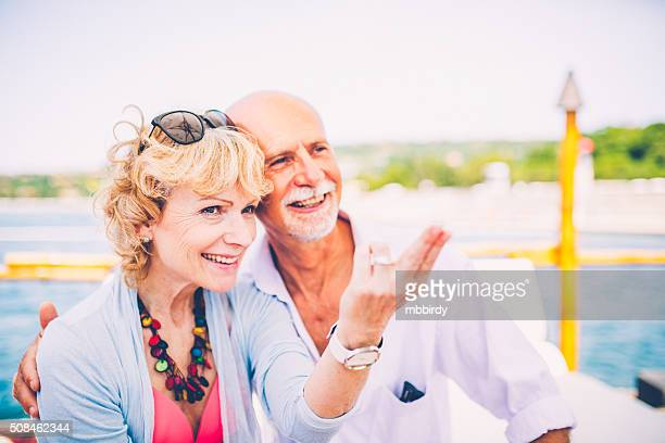 Senior couple having fun at sea side