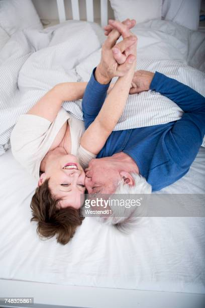 Senior couple having fun in bed