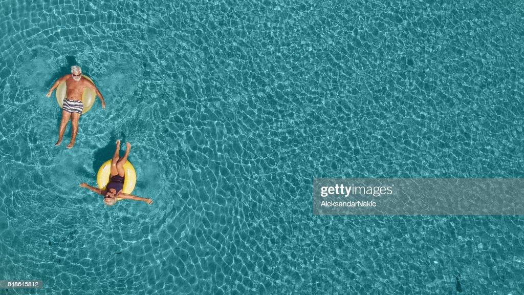 Senior couple having fun in the sea : Stock Photo