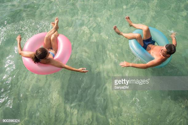senior couple having fun in the sea - butlins stock pictures, royalty-free photos & images