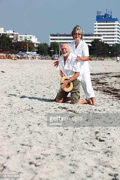 Senior Couple Having fun on the Beach