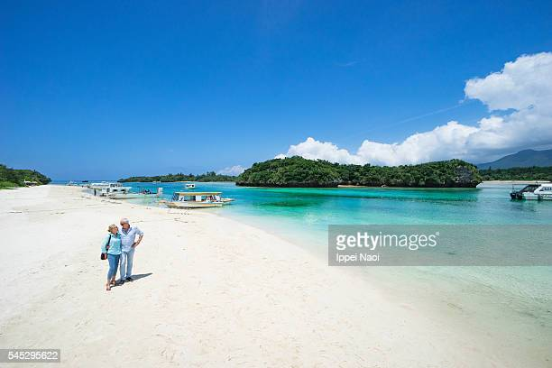 Senior couple having intimate moment on tropical beach, Ishigaki, Japan
