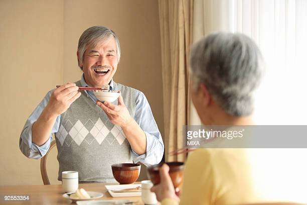 senior couple having meal - 食事 ストックフォトと画像
