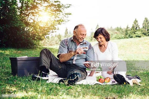 Senior Couple Having Picnic In Nature