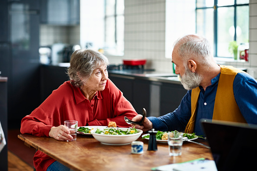 Senior couple having serious discussion over lunch at home - gettyimageskorea