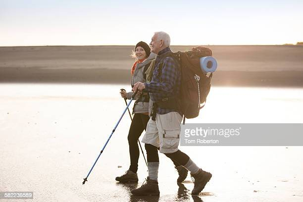 Senior couple hiking along beach