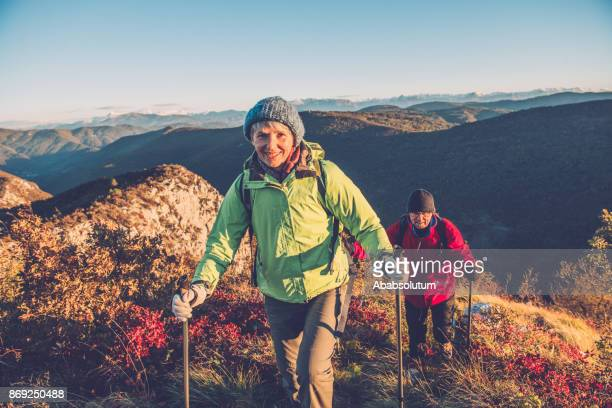 Senior Couple Hiking at Autumnal Dawn in Southern Julian Alps, Europe
