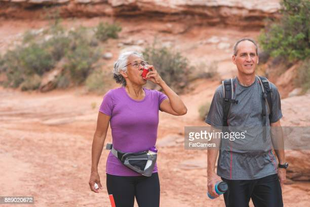 senior couple hiking in desert - asthmatic stock photos and pictures