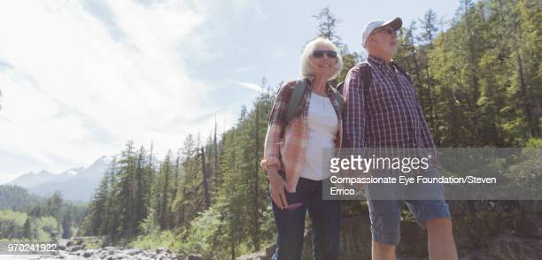 Senior couple hiking in mountains