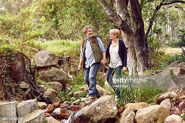 Senior couple hiking in park