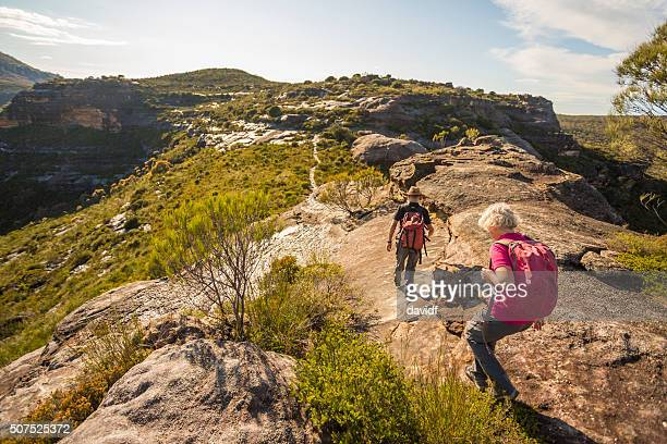 senior couple hiking in spectacular blue mountains australian landscape - katoomba stock pictures, royalty-free photos & images