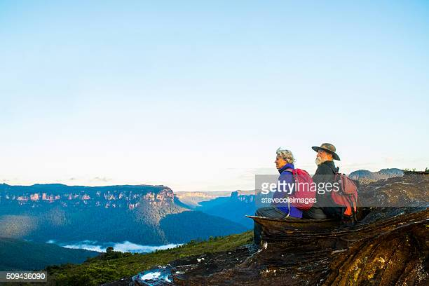 senior couple hiking in the australia outback. - blue mountains national park stock pictures, royalty-free photos & images