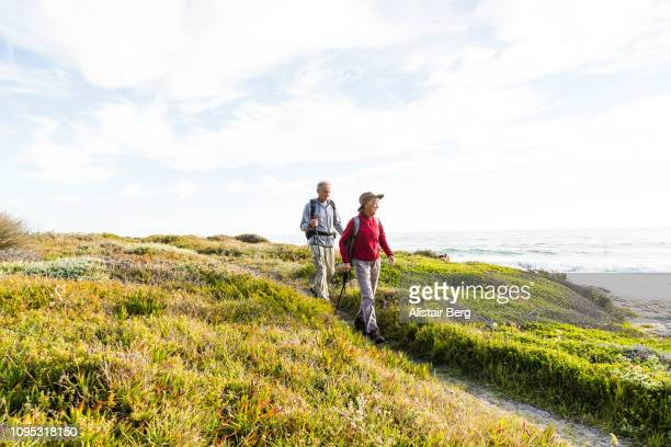 senior couple hiking - activity stock pictures, royalty-free photos & images