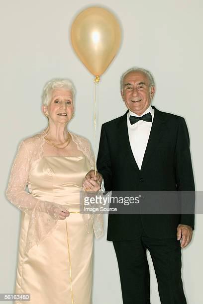 Senior couple holding a balloon