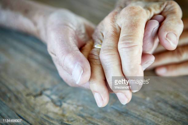 senior couple holding hands, close-up - dementia stock pictures, royalty-free photos & images