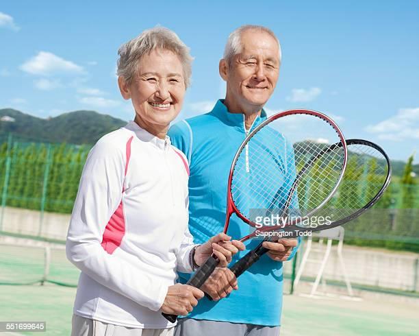 Senior Couple Holding Racquet