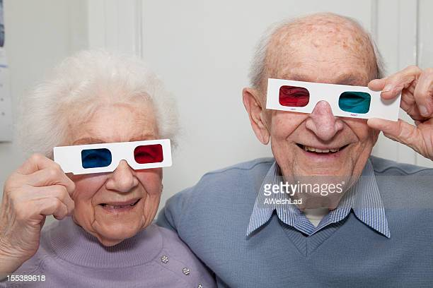 Senior couple holding red- blue 3D glasses