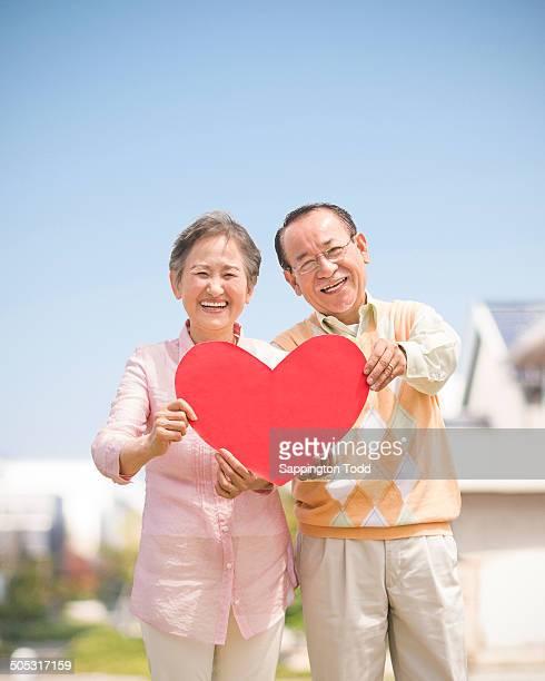 Senior Couple Holding Red Heart