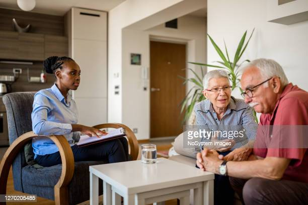 senior couple home mental health therapy - small group of people stock pictures, royalty-free photos & images