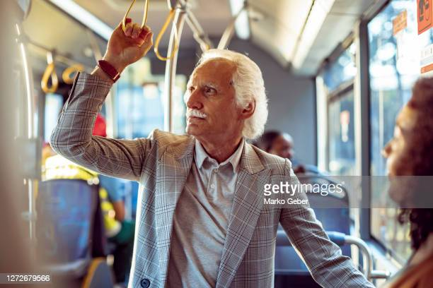 senior couple in a bus - charming stock pictures, royalty-free photos & images