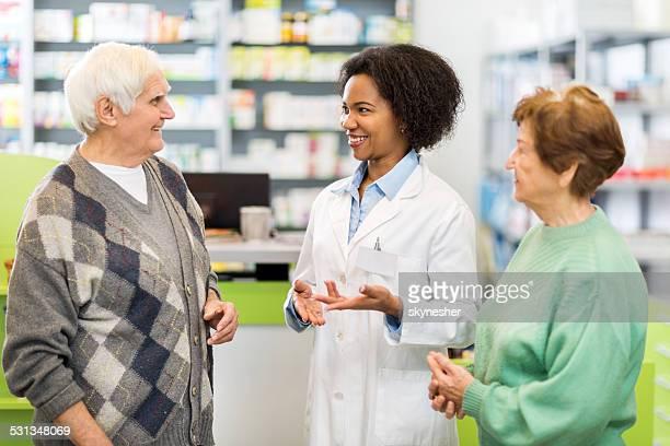 Senior couple in a pharmacy.