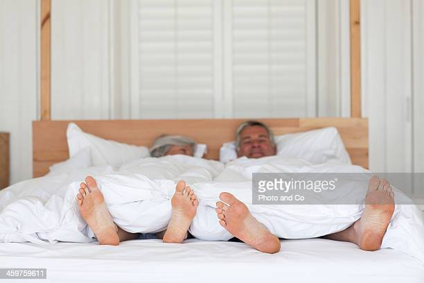Senior couple in bed sleeping