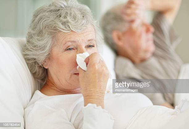 senior couple in bed with the flu - old woman in sick bed stock photos and pictures