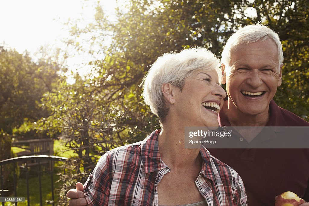 Senior couple in front of lake : Stock Photo