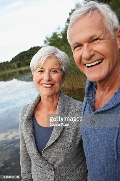 Senior couple in front of lake