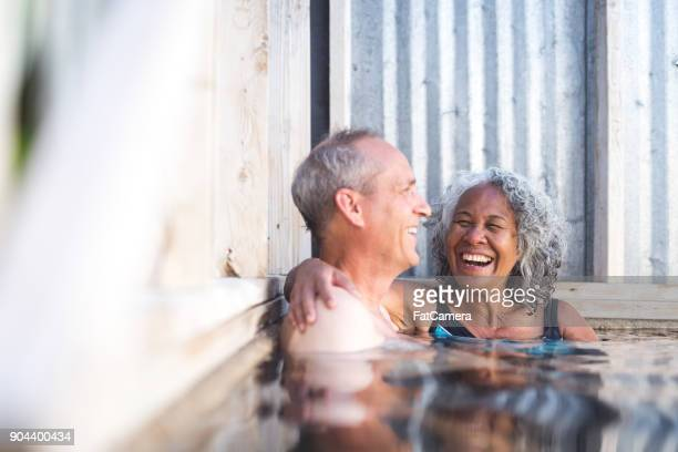 senior couple in hot springs together - pacific islander stock pictures, royalty-free photos & images