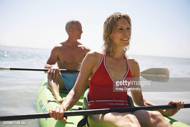 Senior couple in kayak smiling, close-up