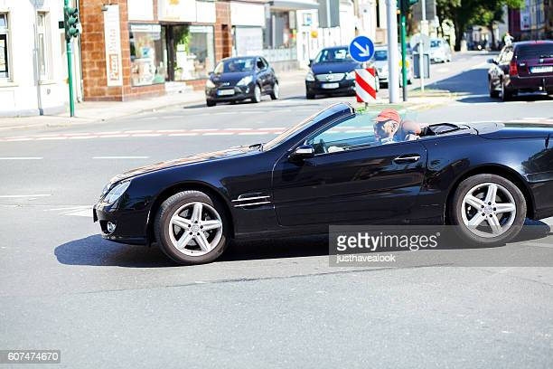 senior couple in mercedes convertible car - mercedes benz stock pictures, royalty-free photos & images