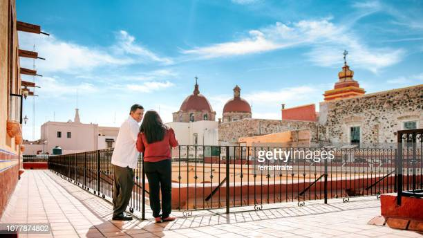 senior couple in mexican hotel rooftop - queretaro state stock pictures, royalty-free photos & images