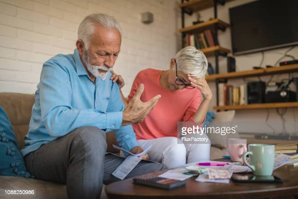 senior couple in need of help with their home finances - weakness stock pictures, royalty-free photos & images